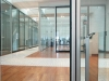 Vertical glass segments for mobile walls