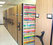 manual_high_density_shelving_systems_with_color_coded_filing_on_the_shelving