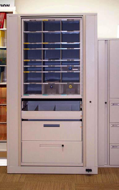 Rotary files with mail slots. Systems like this are available on Texas State Contract (TXMAS). Systems like this are available on GSA Contract